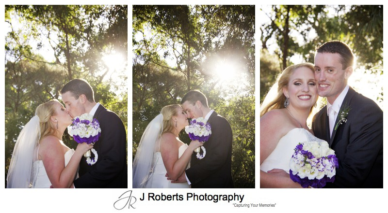 Bride and groom with setting sun through gum trees - wedding photography sydney