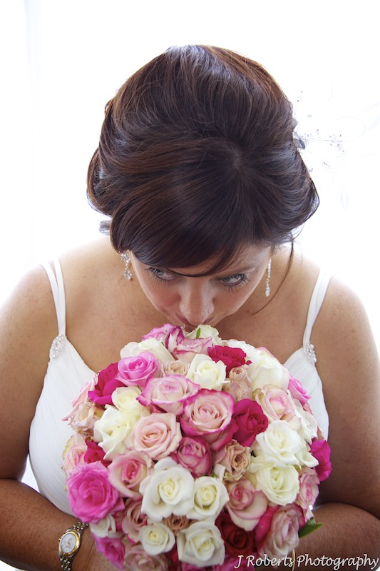 Bride smelling bridal bouquet by Show Posies - wedding photography sydney
