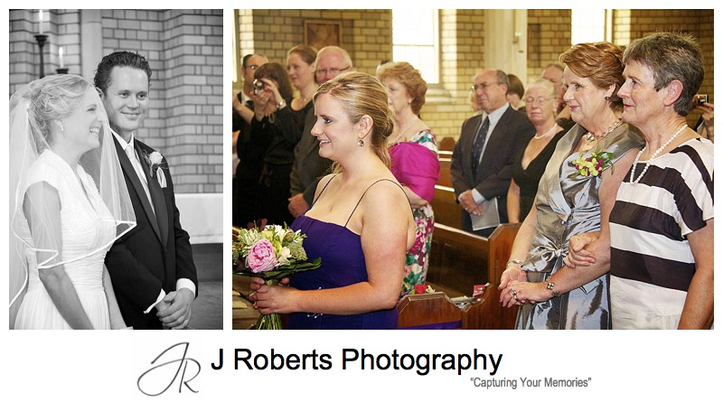 Bride laughing during ceremony and family looking on - wedding photography sydney