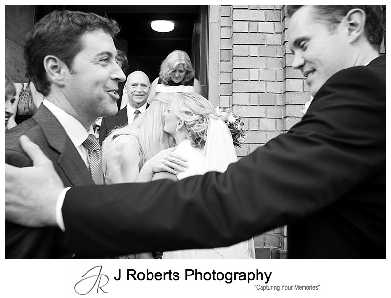Bride and groom being congratulated after marriage - wedding photography sydney