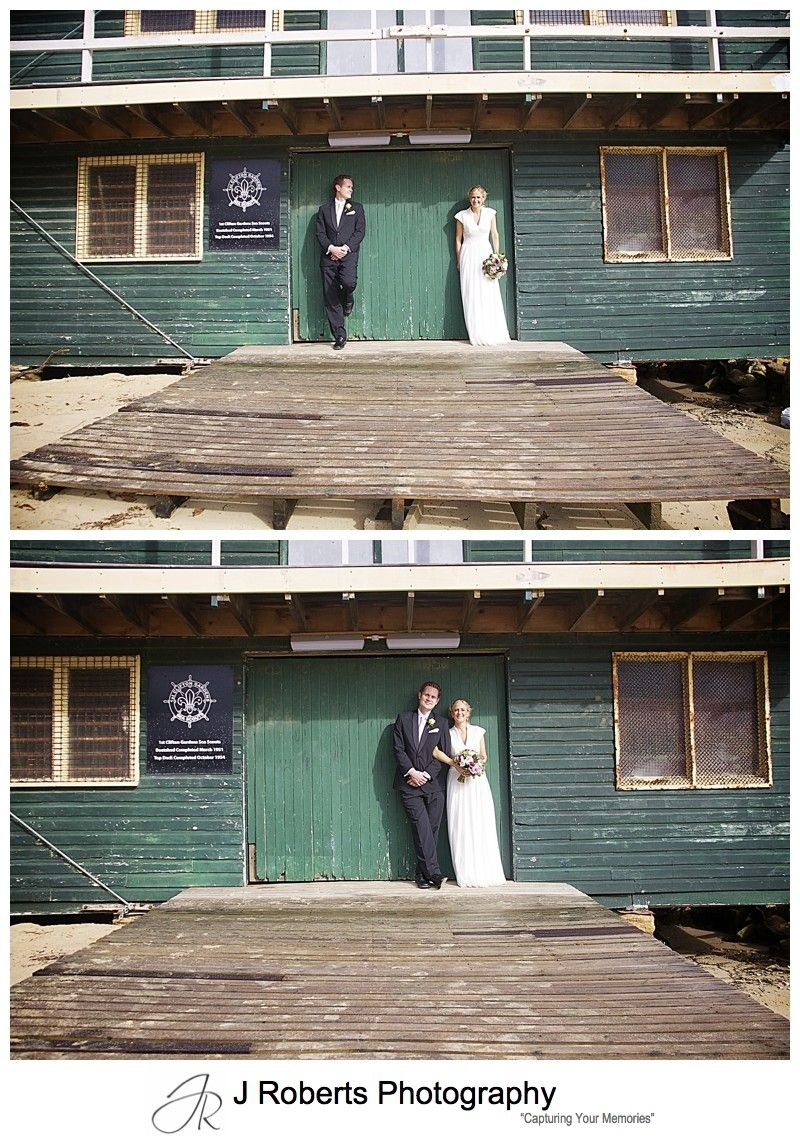 Couple leaning on wooden doors at 1st Clifton Gardens Sea Scout Hall - wedding photography sydney