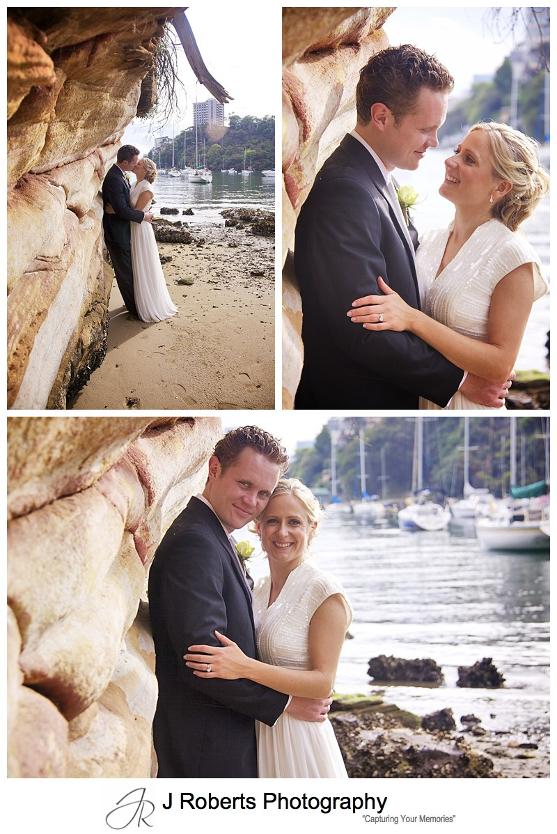 Couple embracing near sandstone rock face - wedding photography sydney