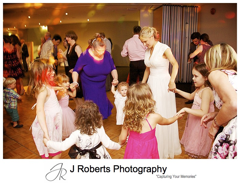 Little girls dancing at wedding reception Taronga zoo Function centre - wedding photography sydney