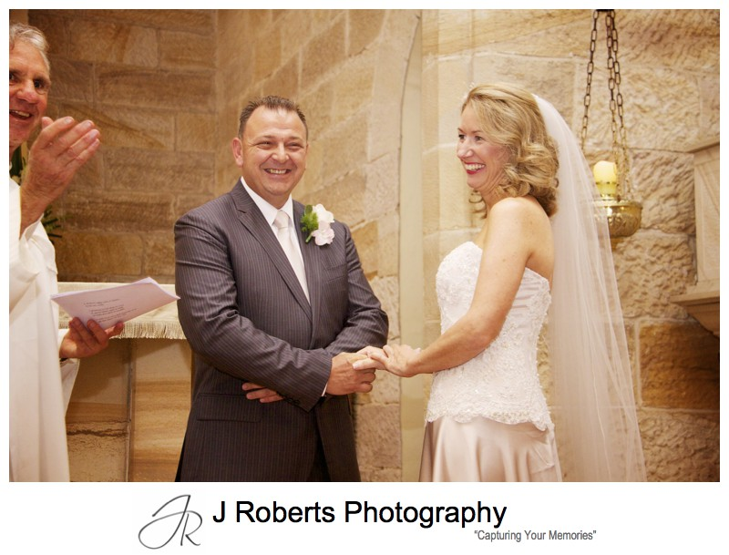 Bride and groom laughing during wedding ceremony - wedding photography sydney