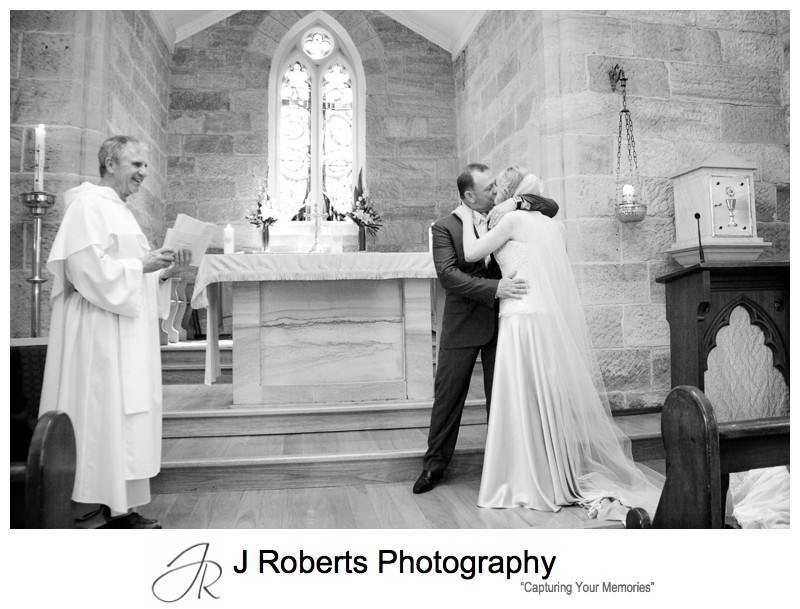 Couples first kiss at St Bedes Pyrmontb - wedding photography sydney