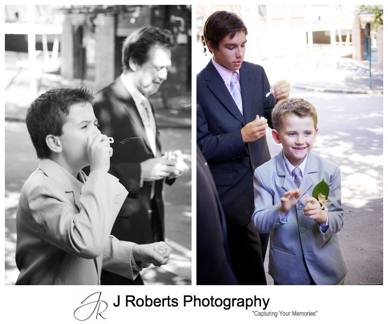Paige boys blowing bubbles in celebration - wedding photography sydney