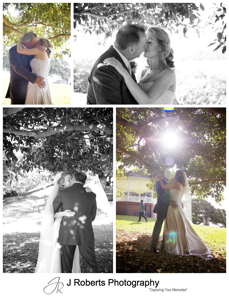 Couple kissing under fig trees at observatory hill - wedding photography sydney