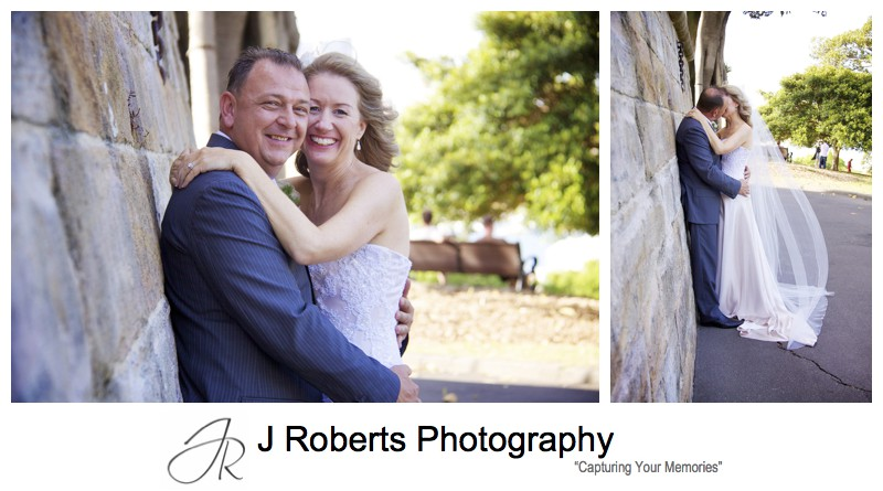 Bride and Groom against sandstone wall - wedding photography sydney