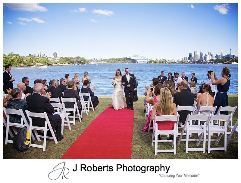 Couple walking up the aisle - wedding photography sydney