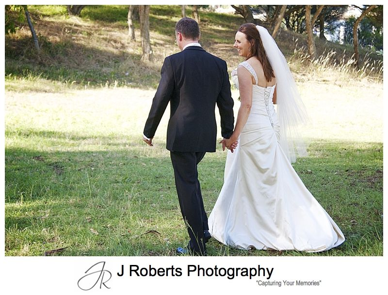 Couple walking through the park - wedding photography sydney