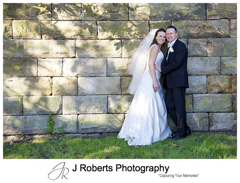 Portrait of a couple in front of sandstone wall Jeffery St Wharf - wedding photography sydney