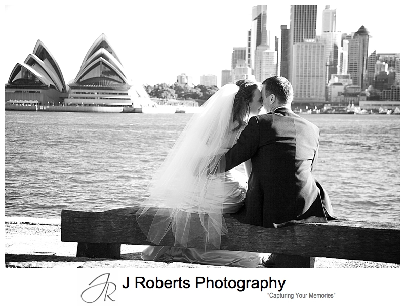 Sillhouette of couple leaning together with Sydney Opera House behind - wedding photography sydney