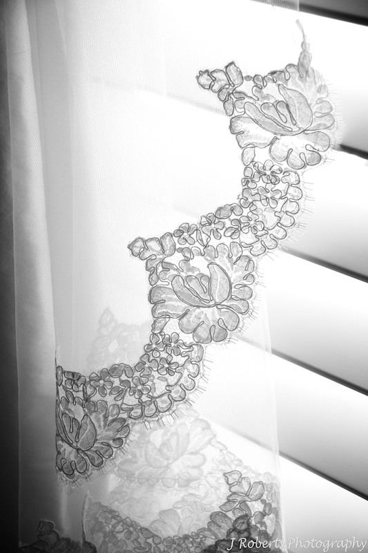 B&W photo of brides veil lace detail - wedding photography sydney