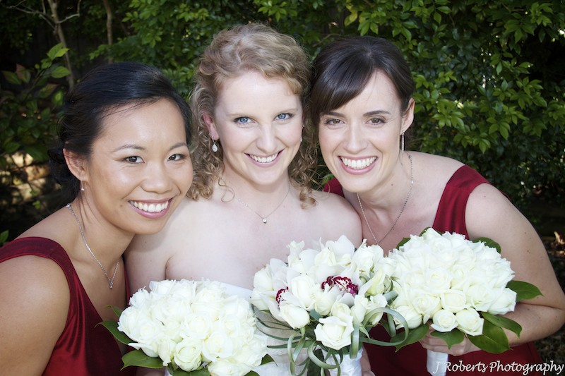 Bride laughing with 2 bridesmaids - wedding photography sydney