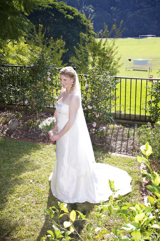 Full length photo of bride in her parents garden pre wedding - wedding photography sydney