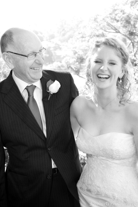 Bride laughing with her father - wedding photography sydney