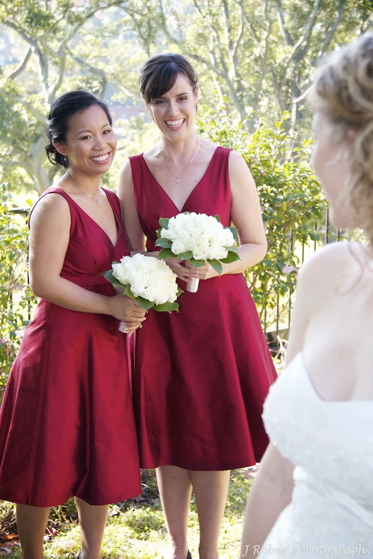 Bridesmaids smiling at the bride - wedding photography sydney