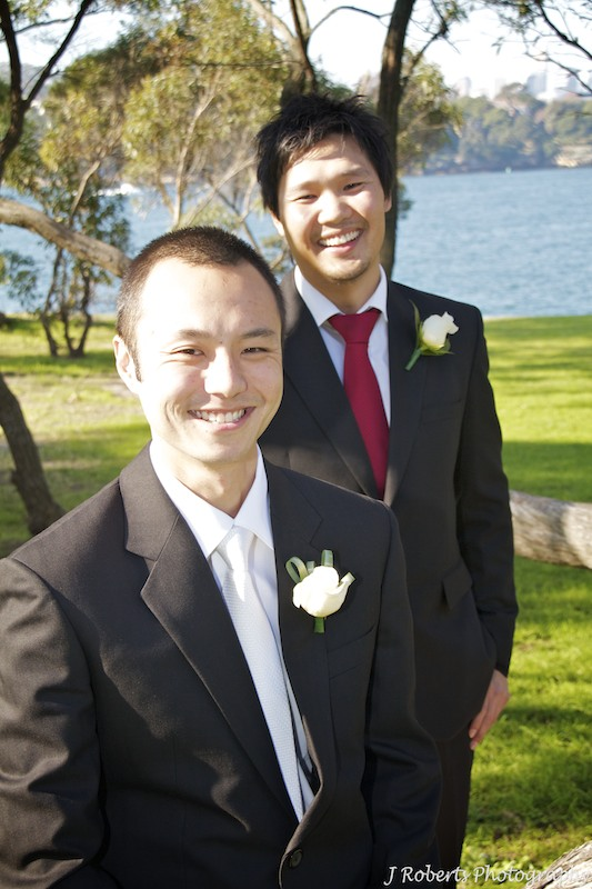 Groom laughing with best man - wedding photography sydney