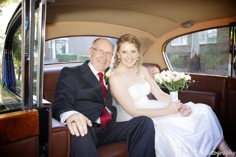 Bride and her father in the wedding car - wedding photography sydney