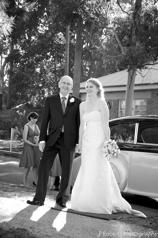 Bride and father getting out of wedding car - weddin gphotography sydney