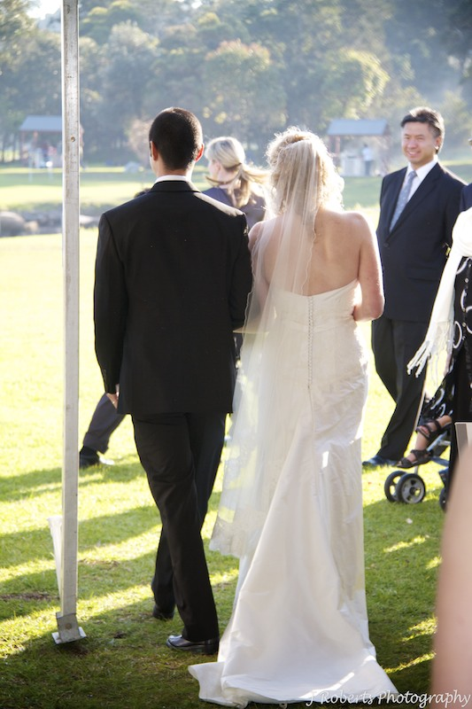 Bride and groom walking back down the aisle - wedding photography sydney
