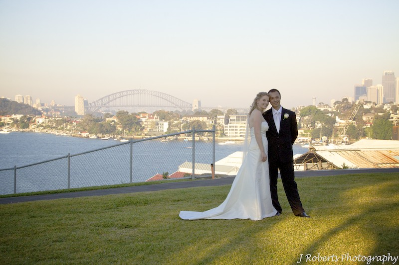 Bride and groom on Cockatoo Island with harbour in the background - wedding photography sydney