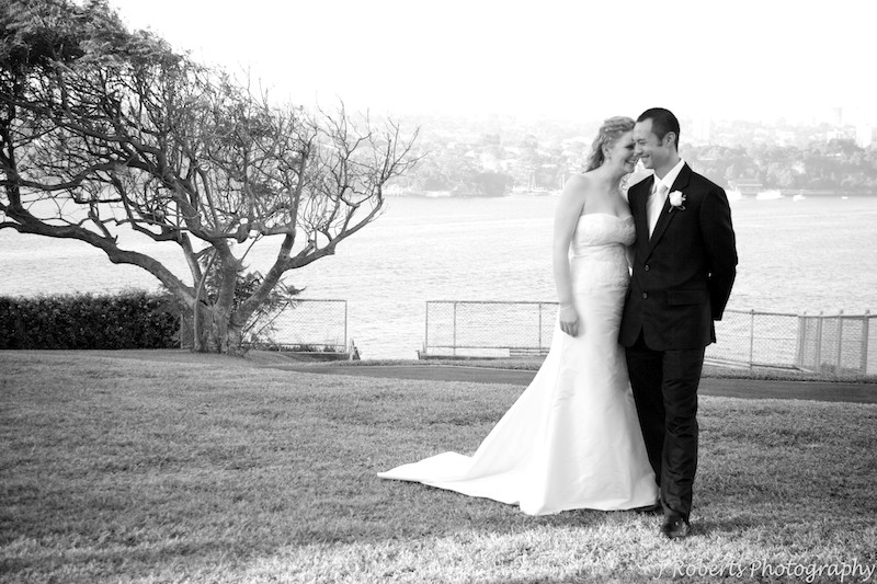 B&W of bride and groom laughing - wedding photography sydney