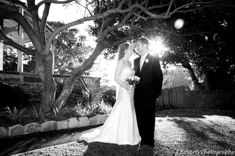 B&W of couple with sun behind - wedding photography sydney