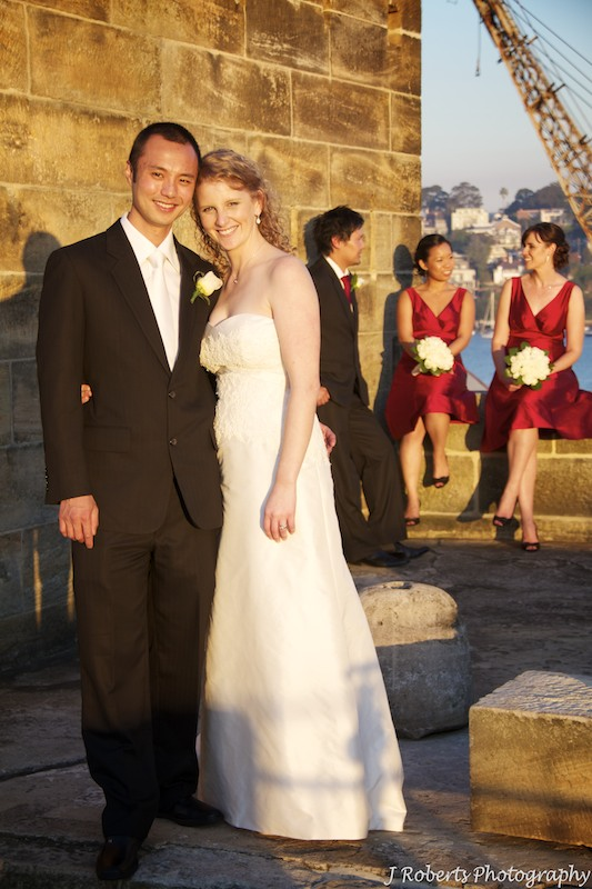 Bride and groom with bridal party behind - wedding photography sydney
