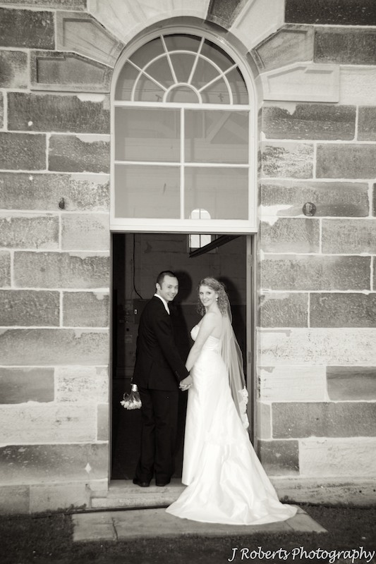 Sepia of couple looking back over shoulders - wedding photography sydney