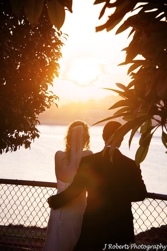 Bride and groom looking into the sunset - wedding photography sydney