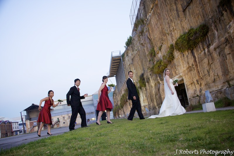 Bridal party reinacting abbey road album - wedding photography sydney