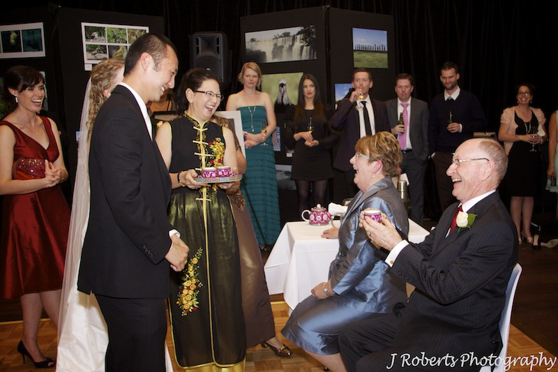 Chinese tea ceremony groom serving in laws - wedding photography sydney