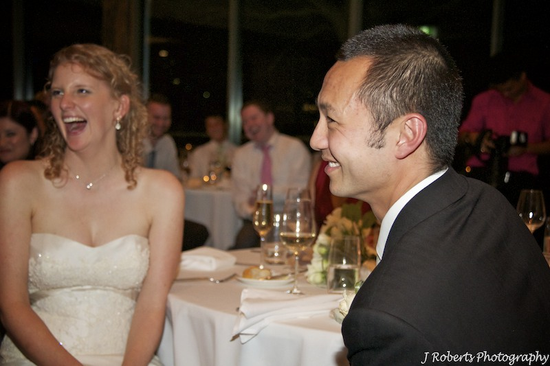 Bridal couple laughing during speeches - wedding photography sydney