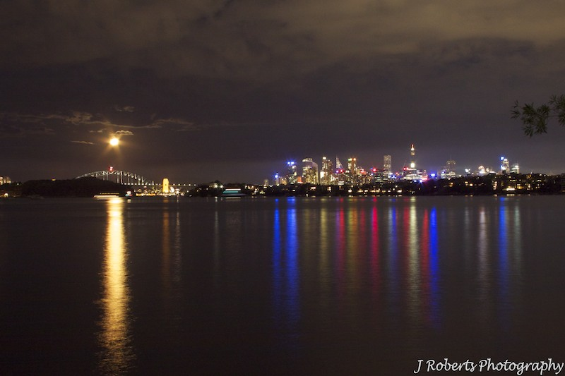 Sydney harbour at night with moon over the bridge - wedding photography sydney