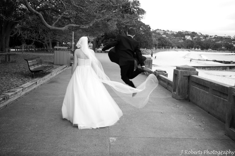 Groom jumping for joy Balmoral Beach - wedding photography sydney